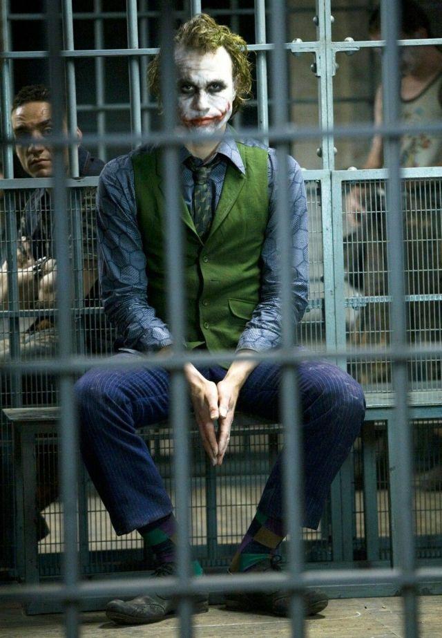 Heath Ledger as Joker in The Dark Knight sitting in jail